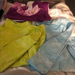 Three longsleeve Nike shirts for girls